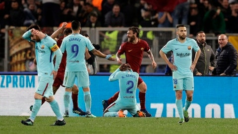 Roma's Daniele De Rossi, 2nd right, celebrates after Kostas Manolas scored his side's 3rd goal, during the Champions League quarterfinal second leg soccer match between Roma and FC Barcelona at Rome's Olympic Stadium, Tuesday, April 10, 2018. (AP Photo/Andrew Medichini)