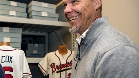 Hall of Fame inductee Chipper Jones laughs as he holds a candy bar named after him during his orientation tour of the Baseball Hall of Fame in Cooperstown, N.Y., Tuesday, April 10, 2018. The former Atlanta Braves slugger toured the Baseball Hall of Fame to prepare for his induction this summer, when he will be inducted along with Jim Thome, Vladimir Guerrero, Trevor Hoffman, Alan Trammell and Jack Morris on July 29. (Milo Stewart Jr./National Baseball Hall of Fame and Museum via AP)