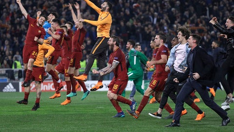 Roma players celebrate reaching the semifinals after the Champions League quarterfinal second leg soccer match between between Roma and FC Barcelona, at Rome's Olympic Stadium, Tuesday, April 10, 2018. (AP Photo/Gregorio Borgia)