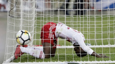 New York Red Bulls defender Kemar Lawrence reacts from inside the goal after missing a shot against Guadalajara during the first half of the second leg in a CONCACAF Champions League soccer semifinal, Tuesday, April 10, 2018, in Harrison, N.J. (AP Photo/Julio Cortez)
