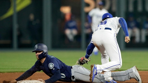 Kansas City Royals second baseman Whit Merrifield (15) tags out Seattle Mariners' Mike Marjama during the fifth inning of a baseball game at Kauffman Stadium in Kansas City, Mo., Tuesday, April 10, 2018. Marjama was caught stealing on the play. (AP Photo/Orlin Wagner)