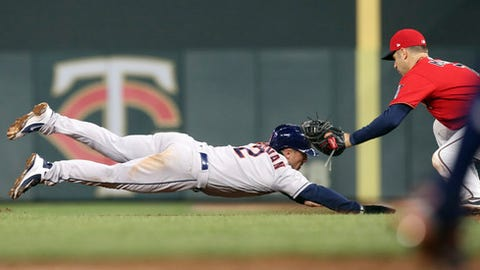 Minnesota Twins first baseman Joe Mauer reaches to tag out Houston Astros' Alex Bregman on a pickoff during the fifth inning of a baseball game Tuesday, April 10, 2018, in Minneapolis. (AP Photo/Jim Mone)