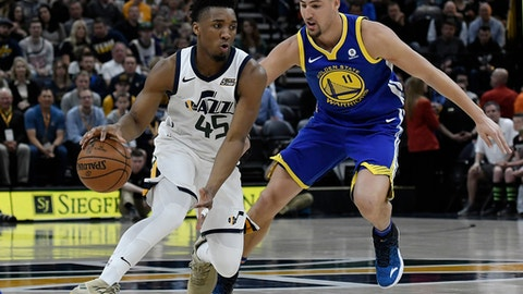 SALT LAKE CITY, UT - APRIL 10: Donovan Mitchell #45 of the Utah Jazz drives against Klay Thompson #11 of the Golden State Warriors in the first half of a game at Vivint Smart Home Arena on April 10, 2018 in Salt Lake City, Utah. (Photo by Gene Sweeney Jr./Getty Images)