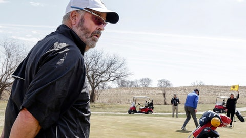 In this April 5, 2018 photo, Bellevue University golf team member Don Byers stands with teammates during practice at the Platteview Golf Club in Bellevue, Neb. 61-year-old Byers is the oldest athlete in the NAIA since Alan Moore kicked an extra point for Faulkner University of Alabama when he was 61 in 2011. (AP Photo/Nati Harnik)