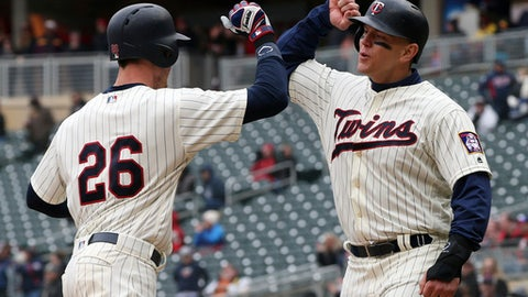 Minnesota Twins' Max Kepler (26) is congratulated by teammate Logan Morrison after Kepler's two-run home run off Houston Astros pitcher Lance McCullers Jr. in the fourth inning of a baseball game Wednesday, April 11, 2018, in Minneapolis. (AP Photo/Jim Mone)