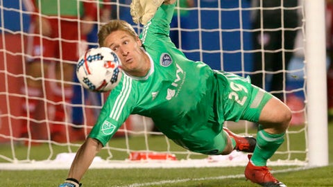 FILE - In this Saturday, April 22, 2017, file photo, Sporting Kansas City goalkeeper Tim Melia (29) defends the goal during the second half of an MLS soccer match against FC Dallas in Frisco, Texas. Melia made his 100th appearance with Sporting Kansas City memorable with a career-high 10 saves. Thing is, he didnt even know he had reached either milestone until afterward. Of all the things that Ive gone through in my career, Im proud of the fact that Im being able to accomplish and have these statistics here, the humble goalkeeper said in retrospect on Wednesday, April 11, 2018. (AP Photo/LM Otero, File)