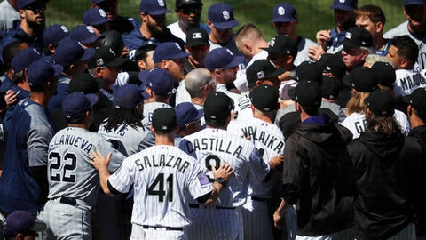 Players from the Colorado Rockies and San Diego Padres scuffle after Colorado's Nolan Arenado was hit by a pitch from Padres starting pitcher Luis Perdomo in the third inning of a baseball game, Wednesday, April 11, 2018, in Denver. (AP Photo/David Zalubowski)