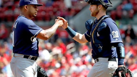 Milwaukee Brewers starting pitcher Junior Guerra, left, is congratulated by catcher Jett Bandy as Guerra leaves a baseball game against the St. Louis Cardinals during the sixth Wednesday, April 11, 2018, in St. Louis. The Brewers won 3-2. (AP Photo/Jeff Roberson)