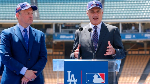 Los Angeles President and CEO Stan Kasten, left, and Baseball Commissioner Rob Manfred announce that Dodger Stadium will host the All-Star Game in 2020 for the first time since 1980 at a news conference in Los Angeles Wednesday, April 11, 2018. (AP Photo/Damian Dovarganes)