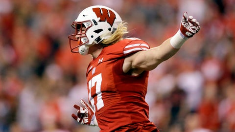 FILE - In this Dec. 2, 2017 file photo, Wisconsin linebacker Andrew Van Ginkel celebrates after recovering a fumble during the first half of the Big Ten championship NCAA college football game against Ohio State in Indianapolis. Wisconsin is retooling at outside linebacker this spring, when coach Paul Chryst will start evaluating potential replacements for the productive Garret Dooley and Leon Jacobs. Andrew Van Ginkel seems set to fill one starting spot. The Badgers though are set at inside linebacker, where All-American T.J. Edwards is back to lead a strong group. (AP Photo/AJ Mast, file)