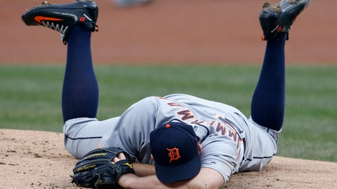 Detroit Tigers starting pitcher Jordan Zimmermann lays on the mound after getting hit by a ball off the bat of Cleveland Indians' Jason Kipnis during the first inning in a baseball game, Wednesday, April 11, 2018, in Cleveland. (AP Photo/Ron Schwane)