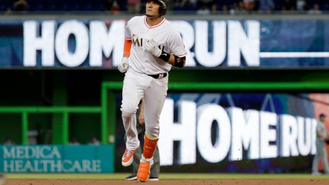 Miami Marlins' Miguel Rojas runs the bases after hitting a solo home run during the first inning of a baseball game against the New York Mets, Wednesday, April 11, 2018, in Miami. (AP Photo/Lynne Sladky)