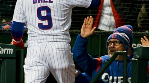 Chicago Cubs' Javier Baez (9) high fives manager Joe Maddon, right, after he hit a three run home run against the Pittsburgh Pirates during the second inning of a baseball game on Wednesday, April 11, 2018, in Chicago. (AP Photo/Matt Marton)