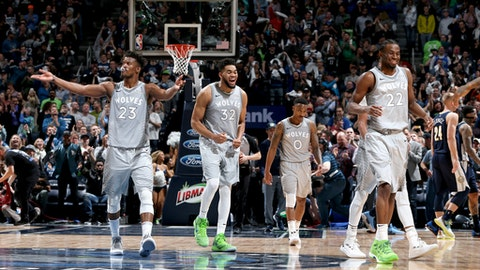 MINNEAPOLIS, MN - APRIL 11:  Andrew Wiggins #22, Karl-Anthony Towns #32, Jeff Teague #0 and Andrew Wiggins #22 of the Minnesota Timberwolves celebrates during the game against the Denver Nuggets on April 11, 2018 at Target Center in Minneapolis, Minnesota. (Photo by David Sherman/NBAE via Getty Images)