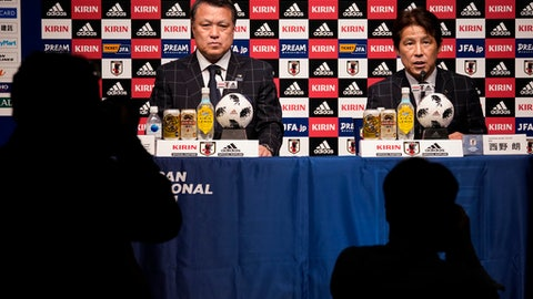 Japan Football Association (JFA) new coach Akira Nishino, right, speaks with JFA President Kozo Tashima during a press conference at its headquarters in Tokyo, Thursday, April 12, 2018. Japan fired coach Vahid Halilhodzic on Monday, two months before the World Cup, and immediately replaced him with Nishino. (AP Photo/Shizuo Kambayashi)