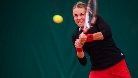 Estonian tennis player Anett Kontaveit  returns a shot  during the first round match against Belarusian Vera Lapko, during the WTA tennis tournament in Lugano, Switzerland, Thursday, April 12, 2018. (Alessandro Crinari/Ti-Press/Keystone via AP)