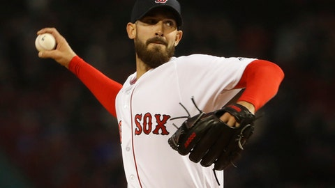 Boston Red Sox starting pitcher Rick Porcello delivers against the New York Yankees during the first inning of a baseball game at Fenway Park in Boston on Thursday, April 12, 2018. (AP Photo/Winslow Townson)