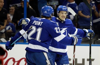 Lightning open playoffs with 5-2 victory over Devils