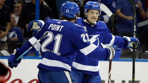 Tampa Bay Lightning center Yanni Gourde right celebrates his goal against the New Jersey Devils with center Brayden Point during the second period of Game 1 of an NHL first-round hockey playoff series Thursday
