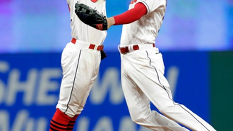 Cleveland Indians' Francisco Lindor, left, and Tyler Naquin celebrate after the Indians defeated the Detroit Tigers in a baseball game Thursday, April 12, 2018, in Cleveland. (AP Photo/Tony Dejak)