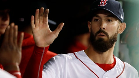 Boston Red Sox starting pitcher Rick Porcello is congratulated in the dugout after leaving the game the baseball game against the New York Yankees following the seventh inning at Fenway Park in Boston Thursday, April 12, 2018. (AP Photo/Winslow Townson)