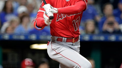 Los Angeles Angels' Shohei Ohtani watches his three-run triple during the seventh inning of a baseball game against the Kansas City Royals on Thursday, April 12, 2018, in Kansas City, Mo. (AP Photo/Charlie Riedel)