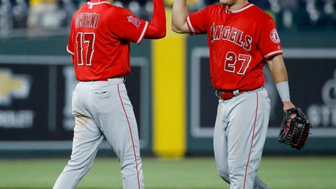 Los Angeles Angels' Shohei Ohtani (17) and Mike Trout (27) celebrate after the team's 7-1 win in a baseball game against the Kansas City Royals on Thursday, April 12, 2018, in Kansas City, Mo. (AP Photo/Charlie Riedel)