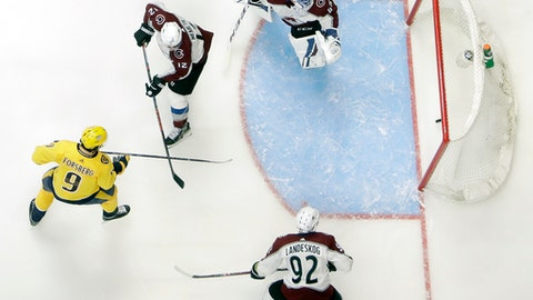 Nashville Predators left wing Filip Forsberg (9), of Sweden, scores a goal against Colorado Avalanche goaltender Jonathan Bernier (45) during the third period in Game 1 of an NHL hockey first-round playoff series Thursday, April 12, 2018, in Nashville, Tenn. (AP Photo/Mark Humphrey)