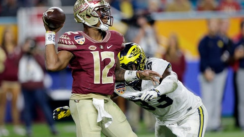 Florida State quarterback Deondre Francois (12) looks to pass under pressure from Michigan defensive end Taco Charlton (33), during the second half of the Orange Bowl NCAA college football game, Friday, Dec. 30, 2016, in Miami Gardens, Fla. (AP Photo/Alan Diaz)