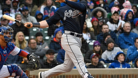 Atlanta Braves' Preston Tucker hits a three-run home run against the Chicago Cubs during the fifth inning of a baseball game on Friday, April 13, 2018, in Chicago. (AP Photo/Matt Marton)