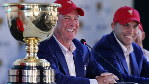 US team captain Jay Haas, left and his son Bill address a press conference after they defeated the International team 15 1/2 to 14 1/2 to retain the Presidents Cup at the Jack Nicklaus Golf Club Korea, in Incheon, South Korea, Sunday, Oct. 11, 2015.(AP Photo/Ahn Young-joon)