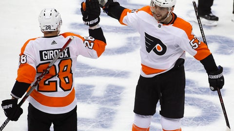 Philadelphia Flyers' Shayne Gostisbehere (53) celebrates his goal with Claude Giroux (28) during the first period in Game 2 of an NHL first-round hockey playoff series against the Pittsburgh Penguins in Pittsburgh, Friday, April 13, 2018. (AP Photo/Gene J. Puskar)