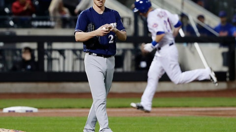 New York Mets' Todd Frazier runs the bases after hitting a home run as starting pitcher Zach Davies reacts of a baseball game Friday, April 13, 2018, in New York. (AP Photo/Frank Franklin II)