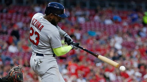 St. Louis Cardinals' Marcell Ozuna (23) hits an RBI-single off Cincinnati Reds starting pitcher Tyler Mahle during the sixth inning of a baseball game, Friday, April 13, 2018, in Cincinnati. (AP Photo/Gary Landers)