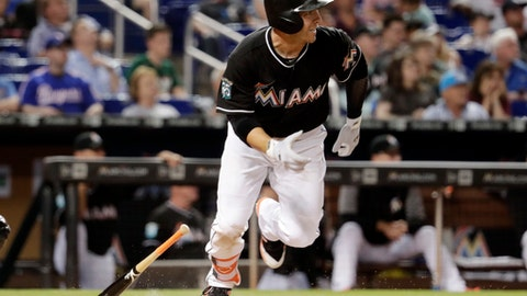 Miami Marlins' JB Shuck leaves the batter's box after hitting a single during the fourth inning of a baseball game against the Pittsburgh Pirates, Friday, April 13, 2018, in Miami. (AP Photo/Lynne Sladky)