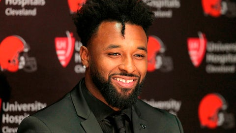FILE - In this March 15, 2018, file photo, Cleveland Browns' Jarvis Landry speaks during a news conference in Berea, Ohio. The Browns have signed wide receiver Jarvis Landry to a five-year, $75 million contract extension, a major commitment before his first game or reception. A three-time NFL football Pro Bowler acquired last month in a trade with Miami, Landry was at the teams headquarters Friday, April 13,  as the Browns continued preparations for an NFL draft that may re-shape their franchise. Landry led the NFL with 112 catches last season and scored nine touchdowns, two more than Clevelands entire receiving corps. (Joshua Gunter/The Plain Dealer via AP, File)