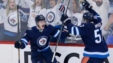 Winnipeg Jets' Andrew Copp (9) and Tyler Myers (57) celebrates Copp's goal against the Minnesota Wild during the third period of Game 2 of an NHL hockey first-round playoff series Friday, April 13, 2018, in Winnipeg, Manitoba. (John Woods/The Canadian Press)