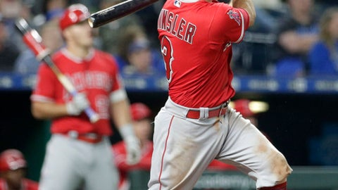 Los Angeles Angels' Ian Kinsler hits a sacrifice fly for the go-ahead run during the eighth inning of a baseball game against the Kansas City Royals, Friday, April 13, 2018, in Kansas City, Mo. (AP Photo/Charlie Riedel)