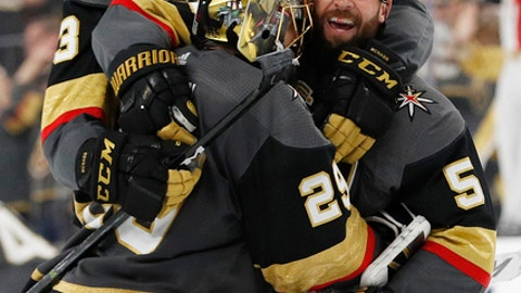 From left, Vegas Golden Knights defenseman Brayden McNabb, goaltender Marc-Andre Fleury and defenseman Deryk Engelland celebrate after defeating the Los Angeles Kings in the second overtime of Game 2 of an NHL hockey first-round playoff series, Friday, April 13, 2018, in Las Vegas. (AP Photo/John Locher)