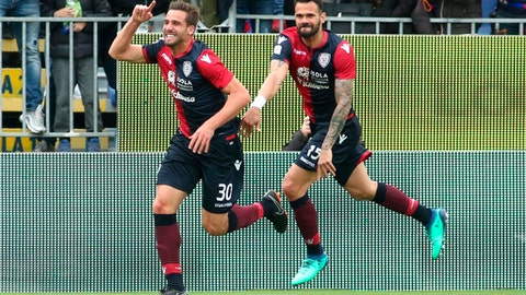 Cagliari's Leonardo Pavoletti, left, celebrates after scoring during the Serie A soccer match between Udinese and Cagliari, at the Sardegna Arena in Cagliari, Italy, Saturday, April 14, 2018. (Fabio Murru/ANSA via AP)