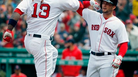 Boston Red Sox's Hanley Ramirez (13) celebrates his two-run home run that also drove in Andrew Benintendi, right, during the first inning of a baseball game against the Baltimore Orioles in Boston, Saturday, April 14, 2018. (AP Photo/Michael Dwyer)