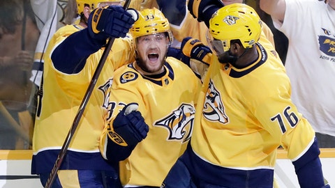 Nashville Predators left wing Viktor Arvidsson (33), of Sweden, celebrates with Mattias Ekholm (14), of Sweden, and P.K. Subban (76) after Arvidsson scored a goal against the Colorado Avalanche during the second period in Game 2 of an NHL hockey first-round playoff series Saturday, April 14, 2018, in Nashville, Tenn. (AP Photo/Mark Humphrey)