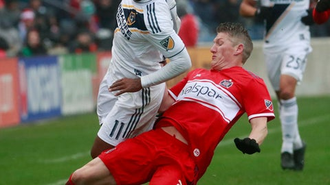 Chicago Fire midfielder Bastian Schweinsteiger (31), gets the ball away from Los Angeles Galaxy forward Ola Kamara (11), during the first half of an MLS soccer match in Bridgeview, Ill., on Saturday, April 14, 2018. (Nuccio DiNuzzo/Chicago Tribune via AP)