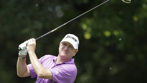 Steve Flesch watches his tee shot on the 12th hole during the third round of the Colonial golf tournament on Saturday, May 25, 2013, in Fort Worth, Texas.  (AP Photo/LM Otero)