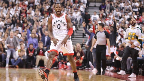 TORONTO, ON - APRIL 14: C.J. Miles #0 of the Toronto Raptors celebrates after making a three-pointer as rap artist Drake celebrates on the sideline against the Washington Wizards in the first quarter during Game One of the first round of the 2018 NBA Playoffs at Air Canada Centre on April 14, 2018 in Toronto, Canada. (Photo by Tom Szczerbowski/Getty Images)