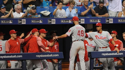 Philadelphia Phillies greet starting pitcher Jake Arrieta at the dugout as he leaves the baseball game against the Tampa Bay Rays during the seventh inning Saturday, April 14, 2018, in St. Petersburg, Fla. (AP Photo/Steve Nesius)