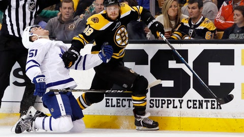 Boston Bruins' David Pastrnak carries the puck past Toronto Maple Leafs' Jake Gardiner during the second period of Game 2 of an NHL hockey first-round playoff series in Boston on Saturday, April 14, 2018. (AP Photo/Winslow Townson)