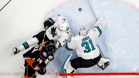 San Jose Sharks goaltender Martin Jones blocks a shot past Paul Martin by Anaheim Ducks center Adam Henrique during the first period of Game 2 of an NHL hockey first-round playoff series in Anaheim, Calif., Saturday, April 14, 2018. (AP Photo/Chris Carlson)