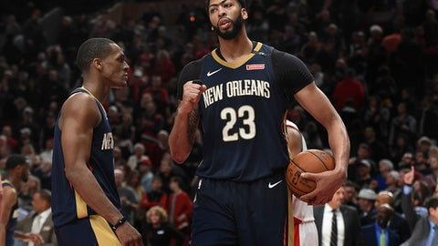 PORTLAND, OR - APRIL 14: Anthony Davis #23 of the New Orleans Pelicans pumps his fist as Rajon Rondo #9 looks on as the horn sounds to end game one of the the first round of the 2018 NBA Playoffs against the Portland Trail Blazers at the Moda Center on April 14, 2018 in Portland, Oregon. The Pelicans won 97-95. (Photo by Steve Dykes/Getty Images)  (Photo by Steve Dykes/Getty Images)