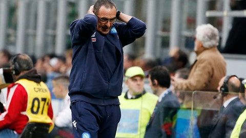 Napoli coach Maurizio Sarri reacts after his players missed a scoring chance during the Serie A soccer match between AC Milan and Napoli at the San Siro stadium in Milan, Italy, Sunday, April 15, 2018. (AP Photo/Antonio Calanni)